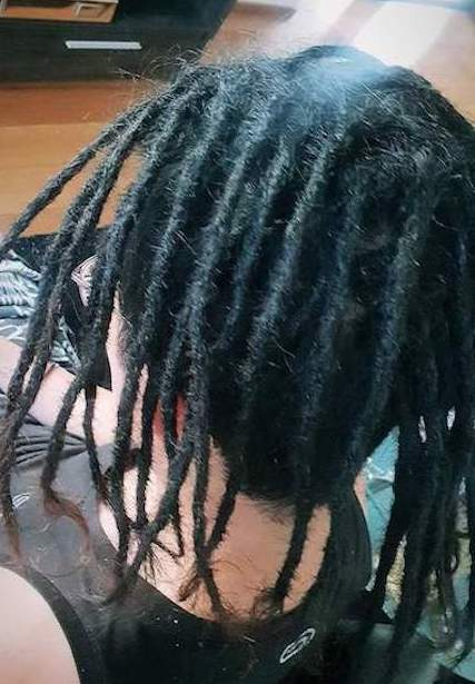 Dreadlocks installation half head Houston after
